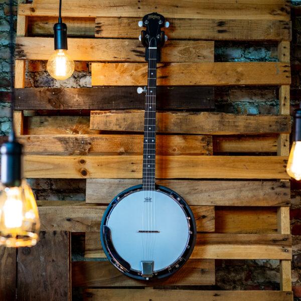 banjo on wood planks