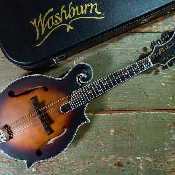 Washburn mandolin beside Washburn case