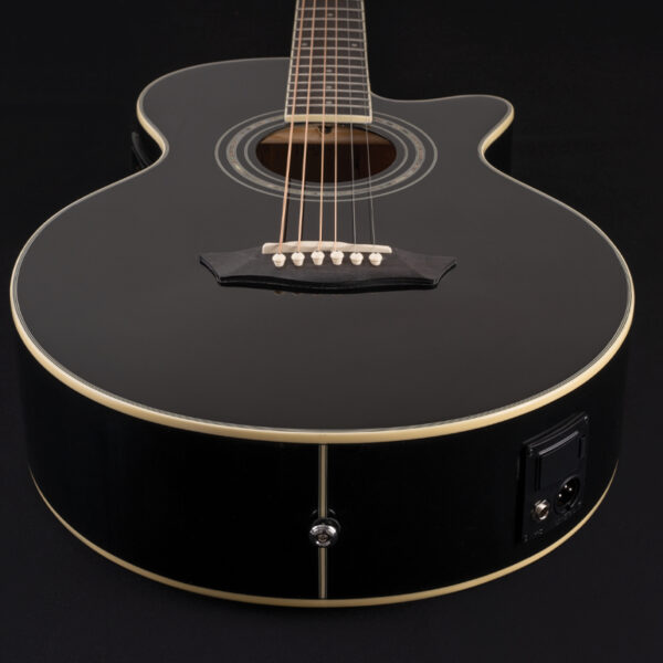 body of black acoustic guitar