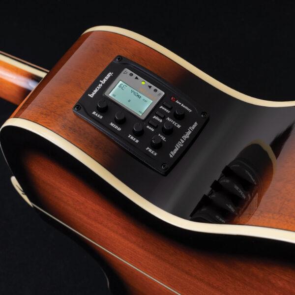 closeup of controls on acoustic guitar