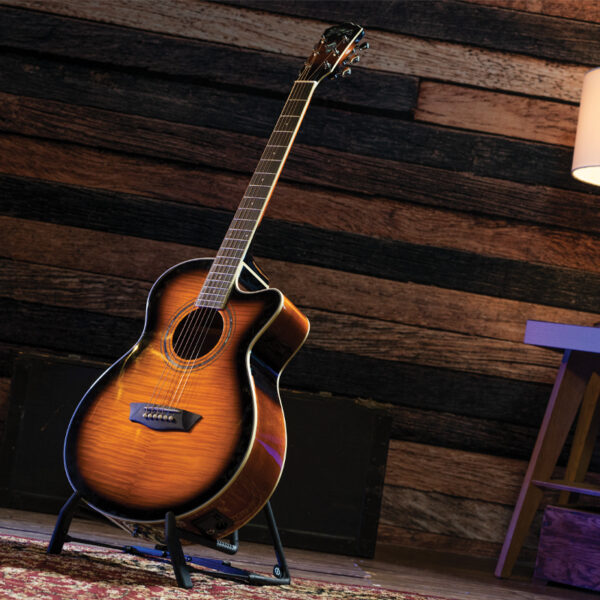 yellow acoustic guitar on stand