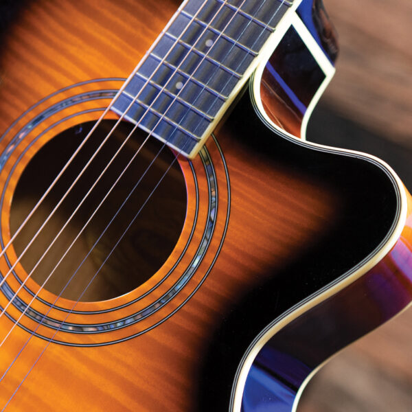 closeup of rosette on yellow acoustic guitar