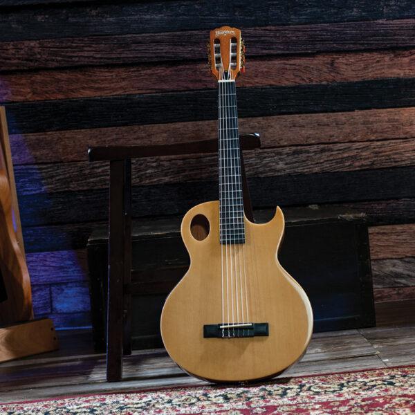 Washburn guitar leaning on stool