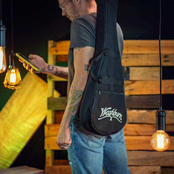 man carrying Washburn gig bag