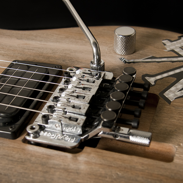 closeup of bridge and saddles on Washburn electric guitar