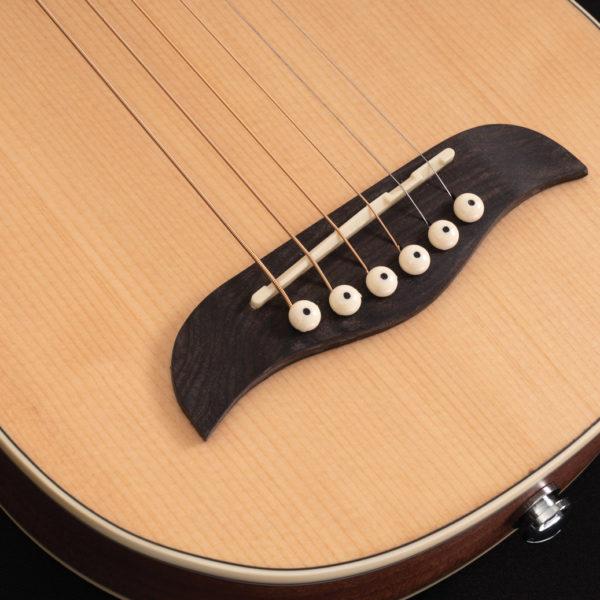 RO10SK Rover Travel Guitar close up of the bridge
