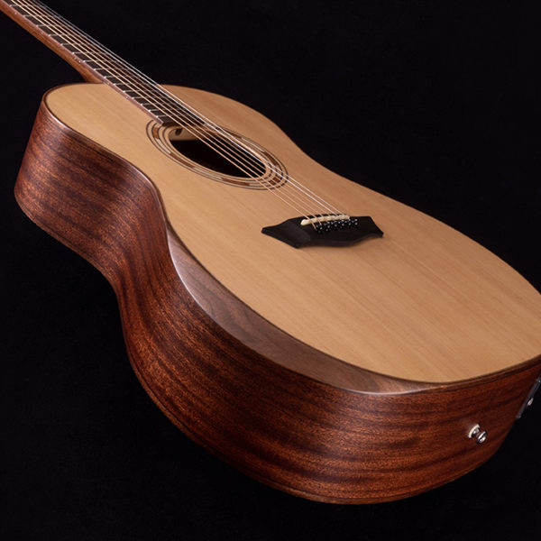 angled side view of Washburn acoustic guitar