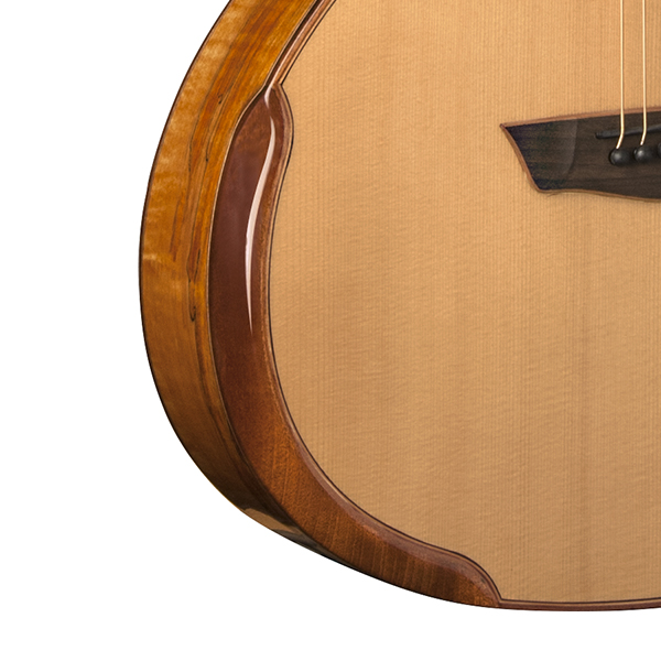 closeup of bevel on body of Washburn acoustic guitar