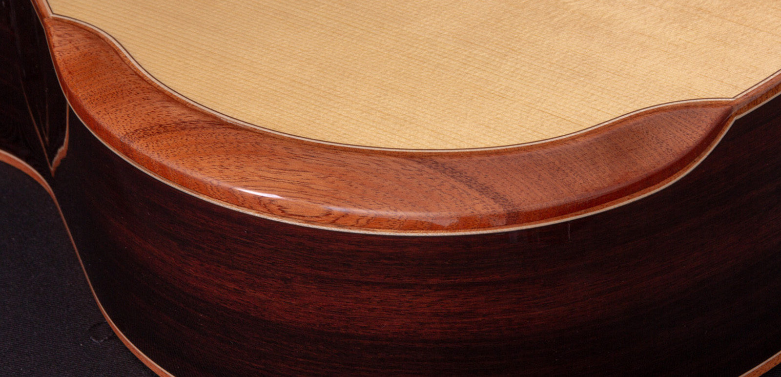 CLOSE UP OF THE COMFORT BEVEL CUT ON COMFORT SERIES GUITARS