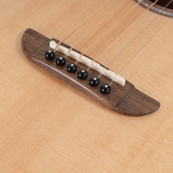 P33S Royal Sapphire Acoustic Parlor Guitar close up of the bridge