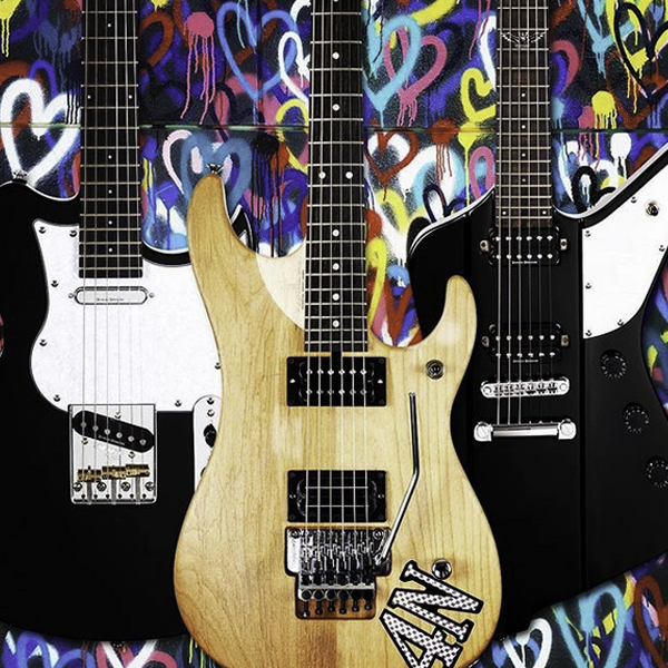 three Washburn electric guitars