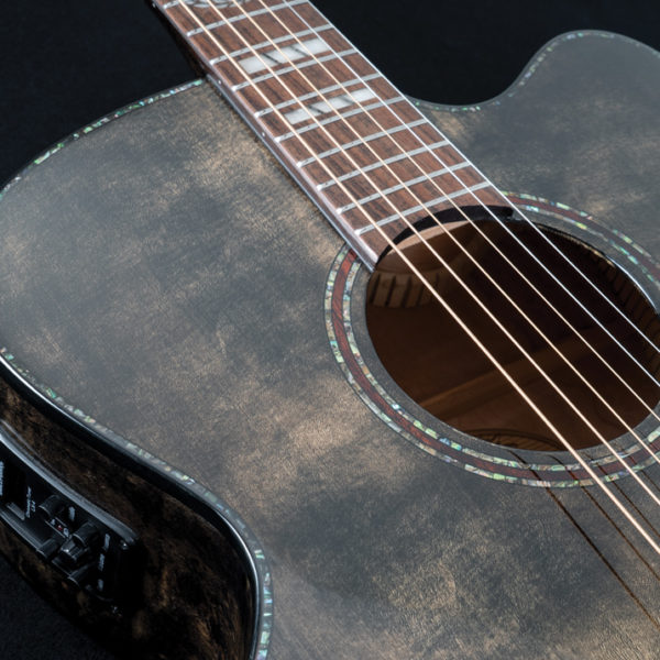 closeup of top of body of Washburn acoustic guitar