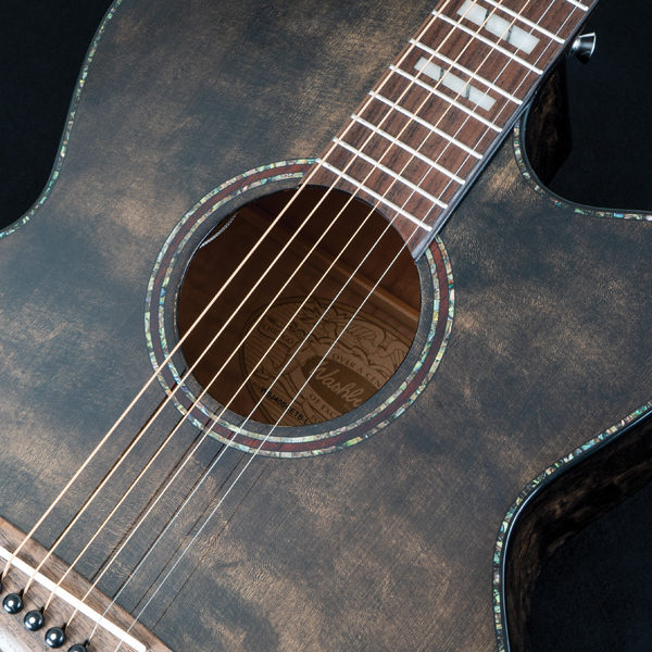 closeup of body of Washburn acoustic guitar