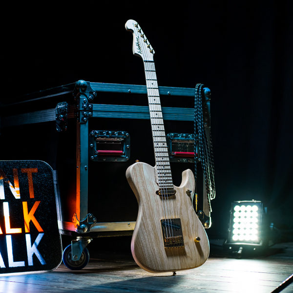 Washburn electric guitar beside Don't Walk sign on stage