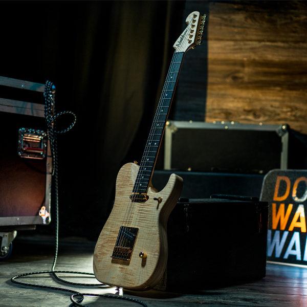Washburn electric guitar among music equipment